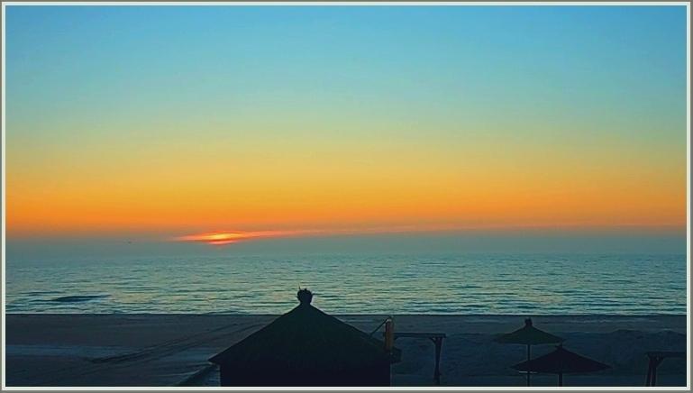 Восход солнца на море в запорожской Кирилловке
