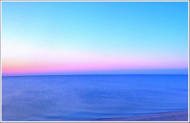 Необычный восход солнца на море в запорожской Кирилловке (фото)